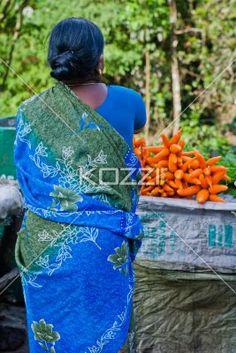 Preparing Carrots - A woman in Munnar, India prepares a bundle of carrots