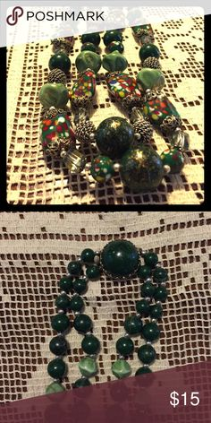 Beautiful green speckled glass vintage necklace Absolutely stunning green and speckled glass bead necklace. Has very interesting spacer beads throughout. I've never seen another one like this. The speckled beads feel like glass but may actually be some other material... they feel like glass to me --they're very glossy and have other spots of color. Necklace is marked Japan and is from the mid century.  Fancy green clasp. A beautiful piece of costume jewelry from decades ago. NOT…