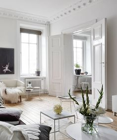 Big solid doors between living areas. Neutrals and clean lines in old an building - via cocolapinedesign.com