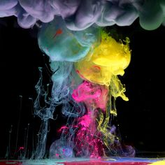 Clouds of vivid colour hang in a black void. These could almost be the latest images from a satellite deep in outer space. However, these pictures are the work of photographer Mark Mawson who uses a secret technique involving paint and water.  Picture: Mark Mawson / Barcroft Media