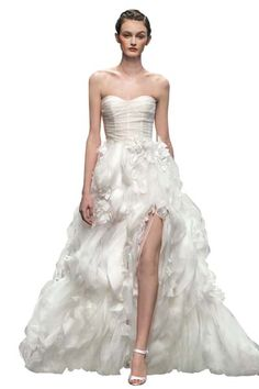 Ruffled wedding gowns are so trendy right now and as I have always loved these styles, my wedding could not have happened at at a better time.  It's going to be hard to choose but I am loving this monique lhuillier wedding gown