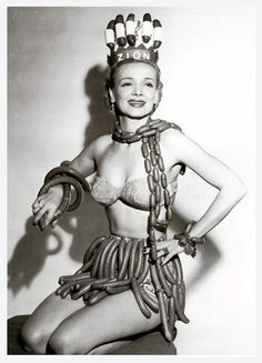 """Would this be considered early Lady Gaga wardrobe? Diving into the wonderful world of bizarre beauty pageants, let's begin with Geene Courtney's """"Sausage Queen."""" The contest was sponsored by the Zion Meat Company during National Hot Dog Week in"""