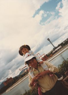 When I was young. With father on his shoulder on a good and fine day.
