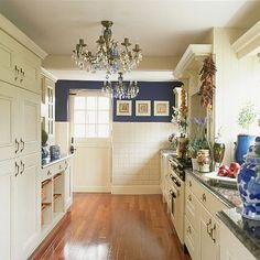 Blue and white galley kitchen