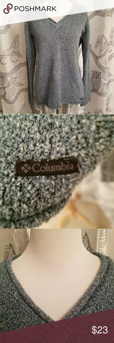 Columbia V-neck Rolled Hem Blue Marbled Sweater Condition: Excellent Used Condition  Brand: Columbia  Color: Blue Size: Medium  Warm and cozy blue sweater by Columbia. V-neck with rolled hems. Perfect for staying warm this winter! Smoke Free home. Columbia Sweaters V-Necks
