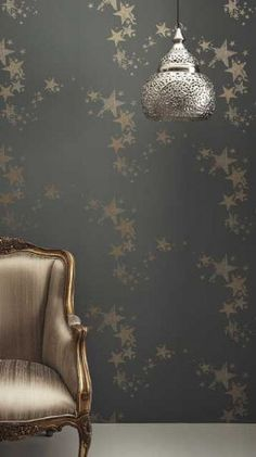 'All Star' wallpaper in the Gunmetal colourway by Barneby Gates.  A fluid constellation of gently decaying stars in a vivid gold on a gunmetal grey background.