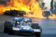 Jackie Stewart - 1970 Spanish Grand Prix at Jarama. With burning wreckage of Jackie Oliver's BRM and Jacky Ickx's Ferrari in the background. Jackie Stewart, John Stewart, Le Mans, 19. April, Aston Martin, Auto F1, Gp Moto, Aryton Senna, Jochen Rindt