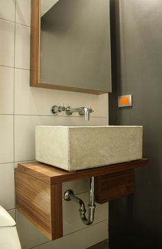 Concrete sink on wood by Central Arquitectura