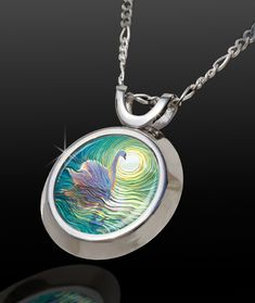White Swan Magical Energy Pendant - From The Magical Chi Collection -- Do you desire peace of mind and an easier life? White Swan spirit, manifested in this pendant is said to bring you: TRANQUILITY, GRACE, INNER BEAUTY, INTUITION and an EFFORTLESS LIFE.