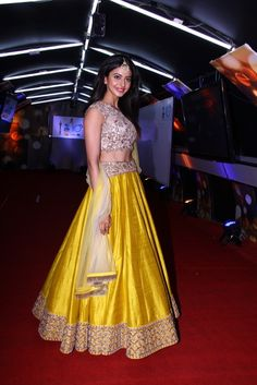 Bollywood Style Sargun Mehta Silk Lehenga In Yellow and Beige Colour Yellow and Beige Colour Silk Fabric Designer Bollywood Lehenga Comes With Matching Blouse Which Can Be Stitched Up To Size Yellow Lehenga, Silk Lehenga, Anarkali, Lehenga Style, Lehenga Blouse, Lehenga Designs, Bollywood Lehenga, Bollywood Fashion, Sabyasachi