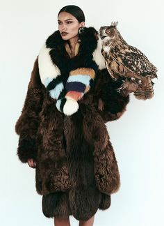 Posing with an owl, the model wears Fendi fur coat and stole with DSquared2 tasseled earrings for FASHION Canada Magazine November 2016 issue