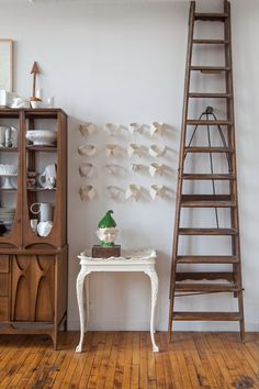 """Sneak Peek: An Eclectic Philadelphia Loft. """"The ladder from the Portland Anthropologie – I bought before I actually bought this loft, so I wasn't even positive that I had a room for it.  The collars were collected from various places through the years. I love what they do on the wall with the little thread ties. I also have a collection of cuffs that I haven't figured out what to do with yet."""" #sneakpeek"""