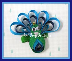 peacock hair clip $8 via etsy... unless some fool will make it for me, with alternate eyes.