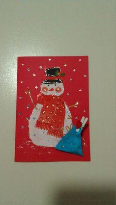 Biglietto natalizio con pacchettino per regalo