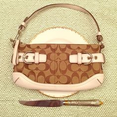 Coach purse (additional pics) I have this purse listed. It is gorgeous! These are additional pictures.  Selling for 40$ !!!!! This is a gorgeous bag at an incredible price! Coach Bags Clutches & Wristlets