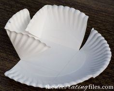 paper plates cut then folded and held with string to create taller basket-type container & 10 Ways to Decorate With Paper Plates | Pinterest | Decoration ...