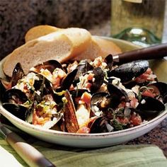 Mussels in Tomato-Basil Wine Sauce | MyRecipes.com  Try it with: Verdicchio, Pinot Grigio, or Bardolino    Julia loves: Donnafugata Chiarandà, Contessa Entellina DOC, Sicily, about $35    Absolutely not required, but consider pairing the ethnicity of the food to the wine.