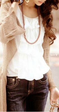 Long sweater and ruffled blouse with jeans Style - essential details