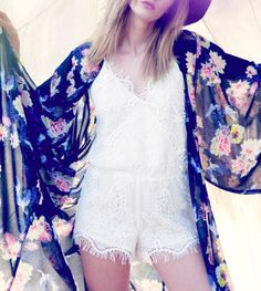 Beautifully tailored, this fully lined white bohemian style romper features a vintage inspired eyelash lace detailing throughout. A front wrap with snap closure