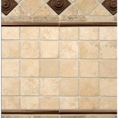 Tumbled travertine w/ copper accents - backsplash. Liking the square tiles; combine with glass/copper mosaic stripe.