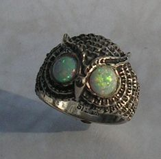 Hey, I found this really awesome Etsy listing at https://www.etsy.com/listing/159189797/sterling-silver-owl-ring-with-opal-eyes