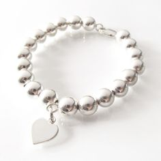 Lauren Everyday Sterling Silver Bracelet - Silver Bead Bracelet - 8mm Bead Bracelet - Sterling Bracelet - 925 Silver Jewelry - Layering Bracelet. This everyday bracelet features seamless and shiny 8mm sterling silver beads ensuring a timeless and elegant look which will be forever stylish.
