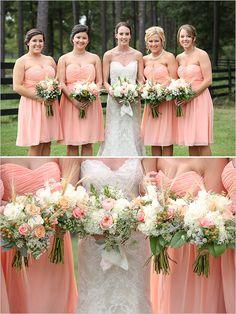 Short peach bridesmaid dresses with peach bouquets.