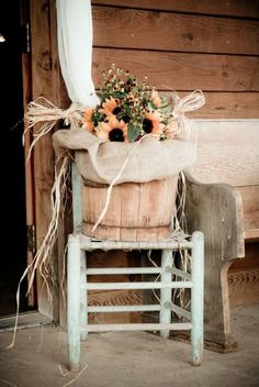 Sunflowers are my favorite flowers. I think this whole set-up would be adorable on a porch. Love it.
