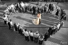 Love this shot of the couple surrounded by family and friends.