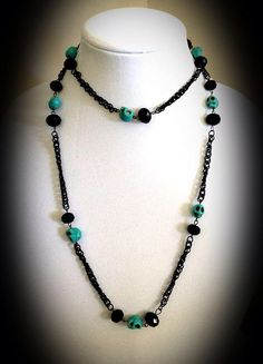 Head Of The Class on Etsy, $40.00 Black crystal faceted beads and turquoise blue skull beads on a long black chain necklace. great for Halloween. This 40 inch long black & turquoise skull necklace can be worn long, wrapped around or turned into a lariat for a variety of looks. It is accompanied by a pair of 3 inch black & turquoise skull earrings as well
