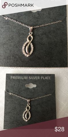 BRAND NEW Silver Plate CZ Crystal Twist Earrings Brand: unbranded  Condition: Brand new with tags  Material: Premium silver plate & CZ stones  Color: Silver  MSRP: $30 Jewelry Necklaces