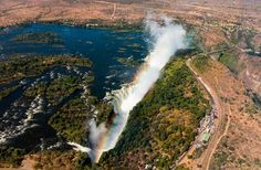 World's Best Aerial Views- Zambia/Zimbabwe Gliding in a tiny Microlight open to the elements can make anyone feel small, but when it's the Flight of Angels circling the mighty wonder of the world, , the experience is completely liberating. As you straddling borders, views of the powerful waterfall and gushing Zambezi River are sure to spur an incredible rush of adrenaline.