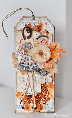 This stunning mixed media tag was created with Prima's gorgeous doll stamp designed by Julie Nutting.
