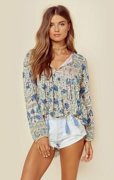 """Miss June's City Printed Blouse features an allover boho inspired print, long balloon sleeves, and ladder cutouts.   ImportedDry Clean Only100% RayonFit Guide:Model is 5ft  8 inches; Bust: 34"""", Waist: 25"""", Hips: 36""""Model is wearing a size XSRelaxed FitShoes Featured Not Available For Purchase"""