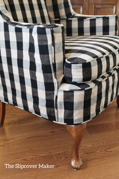 Slipcover in cotton buffalo check tailored to fit a worn & loved wing chair.