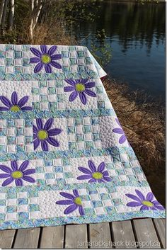 Tamarack Shack: Doo Da Daisy Photos of quilting design and stitching.This is Lorna's second Doo Da Daisy quilt and the pattern is by Amy Bradley. This time Lorna chose purple fabric for the daisies and a . Strip Quilts, Patch Quilt, Applique Quilts, Baby Girl Quilts, Girls Quilts, Quilt Block Patterns, Quilt Blocks, Quilting Projects, Quilting Designs