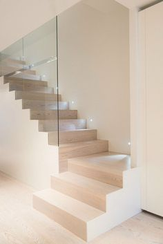 contemporary home interior staircase wood glass panel interior wall Cervantes…