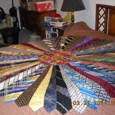 neck tie quilt - what about making it an ottoman or bean bag chair? No directions but it looks fairly simple.