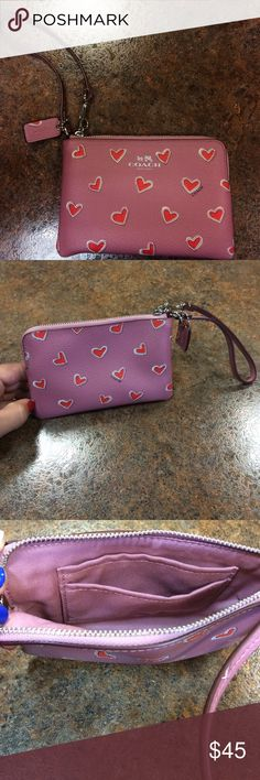 Coach Wristlet, Heart Print Just right for cash, cards and other small essentials. Heart print, two credit card pocket, zip closure, my iPhone fits perfectly! Does not have tags but has never been used! Coach Bags Clutches & Wristlets