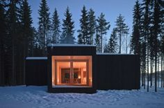 Four-Cornered Villa is an Off-Grid Minimalist Retreat in Finland | Inhabitat - Sustainable Design Innovation, Eco Architecture, Green Building  Love how this building fits its environment; black exterior to match trees, white interior to blend the view with the snow. Lovely! And solar to boot!