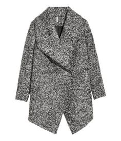 Dark gray melange. Double-breasted coat in mélange, wool-blend bouclé yarn. Wide shawl collar, concealed snap fasteners at front, side pockets, and one