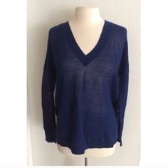 """J. Crew blue top J. Crew blue mesh top. Size small. Measures 29"""" long with a 42"""" bust. Very oversized and cozy! This top is completely see through as it is open knit. 100% merino wool (extremely soft and stretchy). The material tag is coming loose. NWT. Brand new with tags. No trades. Poshmark onlyI am very open to fair offers! J. Crew Sweaters V-Necks"""