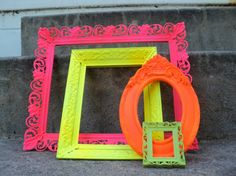 Spray-painted neon vintage frames= great idea for a photo booth setup. Except for have a bright colorful background and neutral frames ( white, grey, gold) buy frames from thrift store/ salvage yard