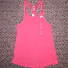 VS Pink oversized lace shoulder tank Sz XS Super nice versatile tank. Coral pink color, oversized and can fit up to a medium with room to spare. Side splits, perfect for workout or casual wear. I may wind up keeping this one, if it doesn't move quickly. Small black marking on tag to prevent returns. Small hole on bottom left hand side from when sensor was removed at the store, unfortunately I didn't notice until it was too late and couldn't return; see last pic. Thanks for looking…