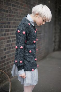 Pink pom-pom Grey Jumper  http://www.thewhitepepper.com/collections/new-in/products/pink-pom-pom-grey-jumper