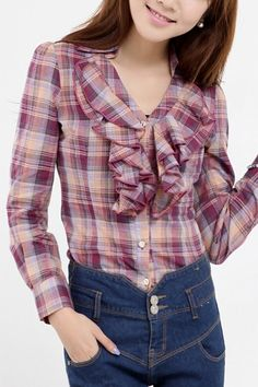 This blouse crafted in cotton, featuring turndown collar, v-neckline, long sleeve with double button fastening, check printing to the main, ruffle detail to front, elastic waist to the reverse, in medium length cut.