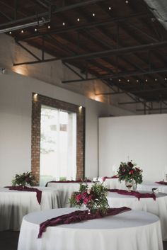 Loft wedding reception with burgundy and gold details | Image by a sea of love