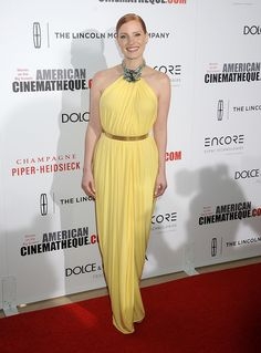 She wears this dress well.  We all can't wear yellow and make it look  this good.