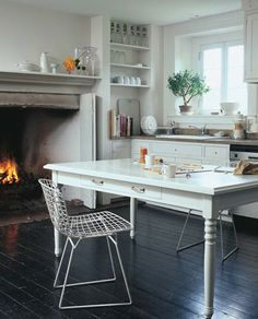 wouldn't everyone love a fireplace in their kitchen