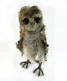 by Emma Hall - a needle felting artist from Ireland who hand crafts incredible textile animal sculptures. She uses tweeds, lace, fleece, yarns, threads, wire, wax and mixed media in creating these creatures.